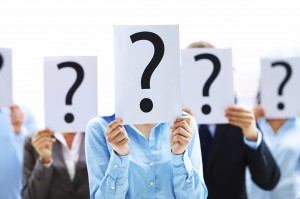 iStock_000011860969_2722x1806_Colleagues-holding-question-mark-signs_Yuri-Arcurs